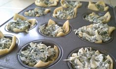 Spinach Artichoke Bites 1 (8 oz.) package softened cream cheese (I used reduced fat) 1/4 cup mayo 1/2 cup grated parmesan or romano cheese 2 cloves garlic, peeled and minced 1 (14 oz.) can artichoke hearts, drained and chopped 1 cup frozen chopped spinach, thawed and drained 2 tubes of crescent roll dough shredded mozzarella (optional, though in my opinion completely necessary)