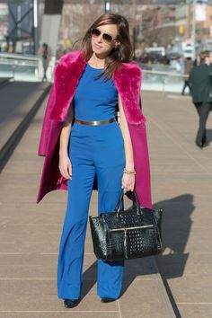 Sydne Style - American Hustling in a bold blue Bebe jumpsuit and French Connection pink coat