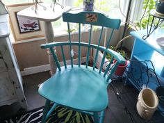 Painted turquoise Antique chair with a decoupage bird.