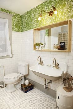 eclectic bathroom- wall-mounted double sink= room for kids stools beneath