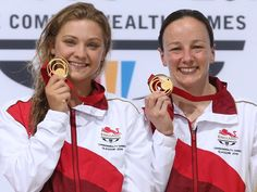 Alicia Blagg and Rebecca Gallantree with their gold medals after winning the synchronised 3m springboard
