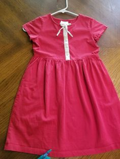 4093edc6fcf Hanna andersson 130 red dress with white button detail and bow.