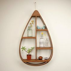 Make a statement on your wall with our Mid-Century Teardrop Shelf. It doubles as convenient, creative storage, with shelving space for frames, decorative plants, and other knickknacks. - Dimensions: 2