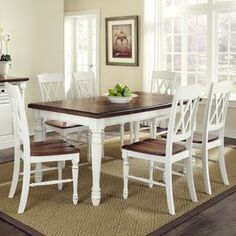 "Seven-piece wood dining set with dining table and six double X-back side chairs.   Product: Dining table and 6 chairsConstruction Material: WoodColor: Brown and whiteFeatures:  Perfect for any dining room or eat-in kitchenDouble X-back chairs Dimensions: 30.25"" H x 48.25"" W x 36"" D (table)"