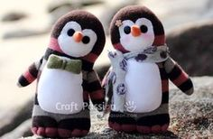 You're Going To Love These Cute And Cuddly Sock Penguins! -  http://www.gottalovediy.com/wp-content/uploads/sites/1137/2015/12/sockpenguin1.jpg - In this craft project you are going to learn how to make your own cute and cuddly sock penguins.   - http://www.gottalovediy.com/cute-and-cuddly-sock-penguins/