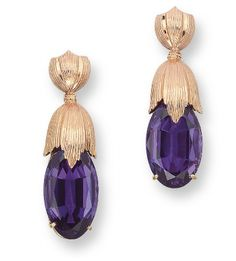 A PAIR OF AMETHYST EAR PENDANTS, BY BUCCELLATI  Each set with an oval-shaped amethyst, to the 18k reeded gold surmount, 4.2 cm long  Signed M. Buccellati, Italy