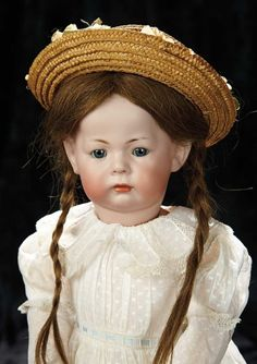 Soirée: A Marquis Cataloged Auction of Antique Dolls and Automata - May 14, 2016: Lot 192. German Bisque Pouting Character, 115A, by Kammer and Reinhardt with Toddler Body