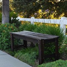 Indoor/outdoor cedar wood bench with a slatted seat and burnt brown finish.  Product: BenchConstruction Material: Cedar woodColor: Burnt brown