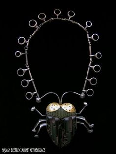 Scott and Lisa Cylinder--Mixed media Squash Beetle Clarinet Key Necklace