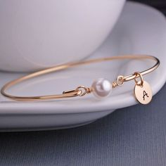 For a timeless look, shop Swarovski pearl bracelets. An Swarovski Pearl is the center of this handmade gold, silver, or rose gold bracelet. Stack bracelets for a layered look or personalize with a charm for the perfect gift. The Bangles, Gold Bangles, Silver Bracelets, Stack Bracelets, Stackable Bracelets, Silver Earrings, Jewelry Bracelets, Sea Glass Jewelry, Pearl Jewelry