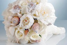 When designing your personal flowers and centrepieces, ask your florist to include seashells