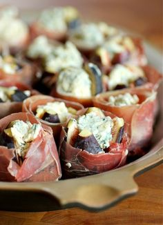 prosciutto wrapped figs stuffed with blue cheese, drizzled with a balsamic reduction