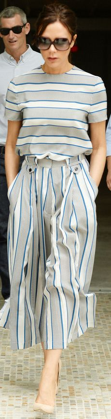Victoria Beckham in a striped top and matching striped culottes