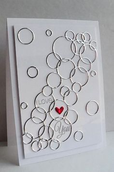 Use your Loopy Rings craft die to create this spectacular handmade valentine's card. Silver foil paper was used for the loops and metallic red for the heart. I think the loops also look like champagne bubbles!