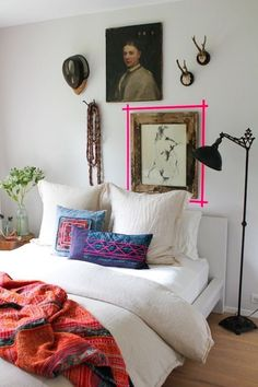 Adding visual tension can be cheap and simple, too. This rustic, global-influenced bedroom looks perfect with a hint of neon washi tape on the wall.