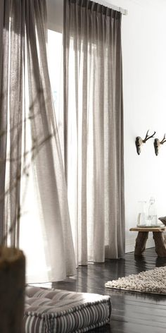 Modern window treatments. Pool the long drapes at the floor for a ...