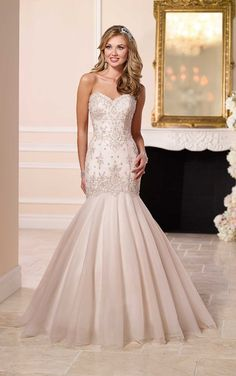 This stunning Stella York fit-and-flare wedding dress is designed for brides who are looking for a romantic, yet sexy gown. See why inside.