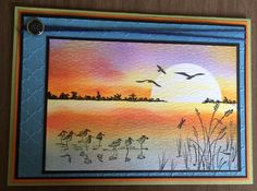 I masked the sun and horizon then blended the BG.  Stamped images.  Scribbled trees on the horizon with black gel pen