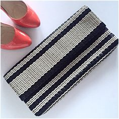 """Banana Republic woven clutch Gorgeous statement clutch in woven black and off white faux leather. Interior slip pocket, magnetic closure. Excellent condition other than a mark on the inside lining (see last pic). Great paired with a bright color! Measures 15"""" by 7.5"""". Banana Republic Bags Clutches & Wristlets"""