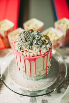 Disco cake topped with silver glittery disco balls Decoration Disco, Disco Party Decorations, Disco Theme Parties, Disco Cake, Disco Birthday Party, Glitter Birthday Cake, 21st Birthday, Roller Skating Party, Gateaux Cake