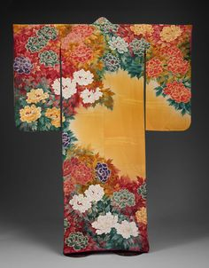 Kimono of silk crepe with occasional weft-patterning of staggered lines in silk and metallic thread; stencil-dyed (kata-yuzen), painted and embroidered with silk and metallic threads, with applied gold paste (kindei-gaki). Design of peonies and peony leaves in white, purple, greens and reds on a shaded mustard ground. Bright pink silk crepe lining, light padding at hem.