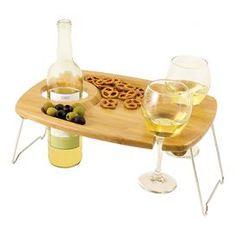 Folding bamboo tray with carved sections for holding wine bottles and glasses.  Product: TrayConstruction Material: BambooColor: Natural woodFeatures:  Carved-out sections to hold a wine bottle and two glassesCarved-out tray in the center of the table provides an area for your appetizersChrome-plated legs fold flat against the table for easy storage and transport Dimensions: 0.5 H x 15 W x 11 D (folded)Note: Assembly required. Glasses and wine bottle not included.