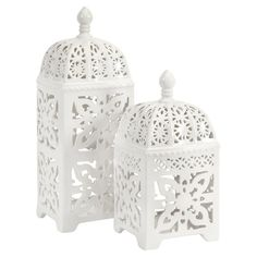 Perfect as part of a stylish entryway vignette or perched on your living room mantel, these lovely candle lanterns showcase a ceramic bases and openwork desi...