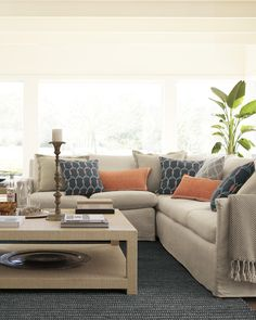 Airy and relaxed with just the right spark of color and pattern. There's a little bit of California in everything we do. Spruce Sectional & Blake Raffia Coffee Table #serenaandlily