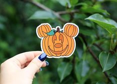 These 3 x 3 inch Mickey Pumpkin stickers are perfect to go anywhere or could make a great gift! Stick them on your laptop, binder, anywhere! They are printed, glossy stickers that are rated for indoor and outdoor use. They do well in sun, heat and cold but do have a sensitivity to skin oils. SHIPPING & PROCESSING TIME All items are made to order and ship next day with 2-7 business days for shipping. You will have your product in hand within 10 business days. Standard domestic shipping from t Disney Halloween Decorations, Halloween Stickers, Cute Halloween, Halloween Themes, Halloween Pumpkins, Pyrography Designs, Disney Pumpkin, Disney Decals, Disney Phone Cases