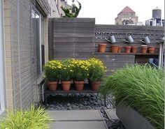 Vasos para jardim com quintal cimentado