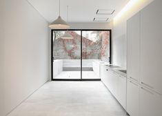 Surfaces of marble and hardwood spread through the rooms of this renovated…