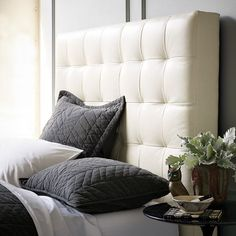 """I think this tall headboard is the perfect disguise for the storage door opening. And it comes in """"elephant"""" color. Perfect! Now, to convince Chris..."""