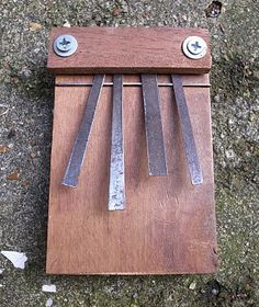 Old saw blade (look for one that resonates) cut into strips, recycled wood, 2 nuts and bolts. This mbira is a mini version of the traditio. School Projects, Projects For Kids, Project Ideas, Making Musical Instruments, Music Instruments, Cub Scouts Bear, Brollies, Forest School, Recycled Wood