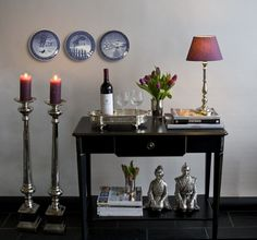 Home Ideas - Antique Royal Copenhagen Christmas plates, lots of silver, black console