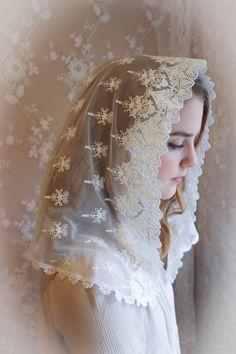 A lovely and lightweight embroidered cream white lace veil is trimmed on the back in a floral Venise lace. (Trim may vary slightly) This is a smaller D shaped veil measuring about 36 X 18. Also available in black. Our veils are soft and comfortable, and wont distract you by slipping off. Evintage veils are handmade in limited production; not mass produced (so when theyre gone, theyre gone) . Quality made in the USA. The history of Our Lady of the Doves is here: http://www.roman-...