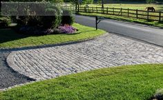 I just don't think you can beat the warm look of real cobble stones........this driveway is in Orange County NY