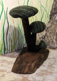 Whimsical Troll Hole Toad Stools made out of upcycled sweaters and found wood by Sigrid