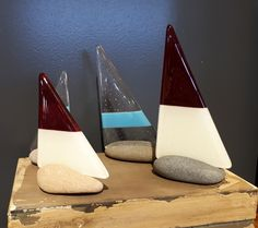 Fused glass boats entitled 'Rock Bottom'. These are unique pieces and all the rocks were sourced in Scarborough.  Starting from £17.50 in store. #fusedglass #gekoglass