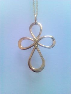 A bespoke 9ct gold Celtic swirl pendant set with diamond.  Designed and made in our Galloway Studios, Castle Douglas http://www.scottishdesignerjewellery.com/design-services-i39