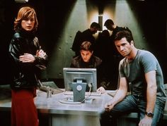 Milla Jovovich (Alice), Martin Crewes and James Purefoy in Resident Evil