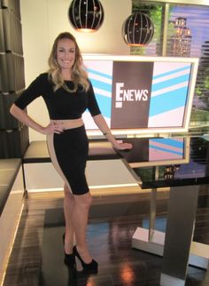 On-air TV host Ashlan Gorse wearing Abyss by Abby's Line of Fire dress in black on E! News, December 5, 2012.