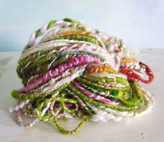 Hand spun yarn Coil Bulky corespun 'summer time happines'. These hand spun yarns are beautiful. So fun to knit with.