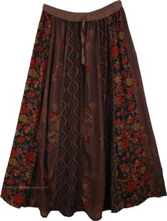 A vertical patchwork cotton skirt that elongates your silhouette, the patchwork is separated by a thick bundled thread running from waist to hem. A classy skirt that you can nothing but love! The classic patchwork look becomes even more fascinating with a complementary selection of patches in fascinating earthen color tones, the entire look creates a feast for the eye, and a look to adore. It has an elastic waist with a drawstring to allow for flexibility and a comfortable fit. You can… Cotton Skirt, Silk Skirt, Dress Skirt, Hippie Skirts, Boho Skirts, Wrap Skirts, Brown Outfit, Elastic Waist Skirt, Gypsy Skirt
