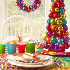 Celebrate the season with all the colors of the rainbow -- the bright hues are perfect for adding holiday cheer to a table! http://www.bhg.com/christmas/indoor-decorating/christmas-color-schemes/?socsrc=bhgpin122214multicolorfestivechristmasscheme&page=10