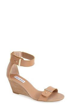 Free shipping and returns on Steve Madden 'Narissaa' Ankle Strap Wedge Sandal (Women) at Nordstrom.com. Gleaming push studs and sleek gilded bars add just the right amount of shine to these modern ankle-strap sandals from Steve Madden. With their lightly padded footbed, just-right wedge and minimalist styling, these sandals are easy to wear and easy to pair.