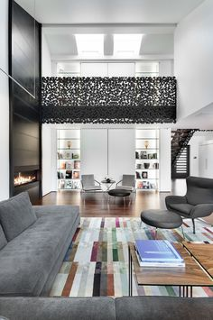 Modern House with Anthracite Iron Laced Staircase by Gestion René Desjardins | DesignRulz