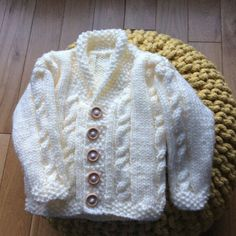 Heirloom Cables Baby Sweater in Lion Brand Vanna's Choice - 60647AD | Knitting Patterns | LoveKnitting