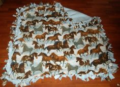 $45.00 Free Shipping  Wild Horses fleece throw blanket. Fits adults and children and would make the perfect gift for any horse lover! Front has many wild horses running with a blue background and the backing will be a beautiful light blue color.  Warm and comfy fleece material! Machine Washable  Approx Size: 58X59