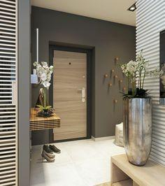 Небольшая уютная квартира для молодой семьи выполнена в современном стиле. Зонирование пространства с помощью стеклянной перегородки дает возможность разместить небольшую спальню и гостиную.
