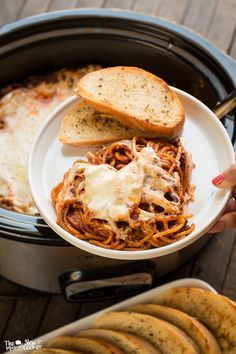 This Slow Cooker Baked Spaghetti is such a treat compared to regular our spaghetti night!